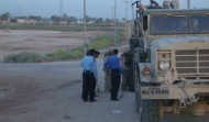 Iraqi Police with downed truck